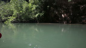 Panorama of tropical river among mangrove trees. Panorama of tropical slow river flowing among mangrove trees and cliffs stock video footage
