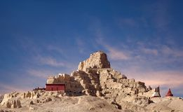 Panorama of Tsaparang in Guge Kingdom, Tibet. Panorama of Tsaparang, the ruins of the ancient capital of Guge Kingdom and Tholing Monastery at sunset in Tibet stock image