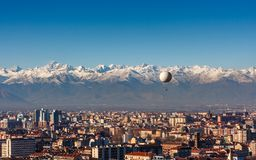 Panorama of Turin, with the Alps in the backround, Turin, Italy. Panorama of Turin, with the Alps in the backround and a hot air baloon, Turin, Italy Stock Photo