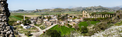 Panorama of Turkish village with ancient roman ruins Royalty Free Stock Photography