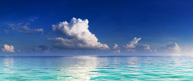 Panorama of turquoise lagoon. And deep blue sky with clouds Stock Photo