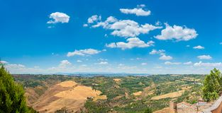 Panorama of the Tuscan valley at sunset, many guest villas on the hills stock image