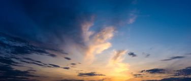 Panorama twilight morning sky and cloud. Panorama twilight morning sky, golden light from sunrise shine to the cloud Stock Image