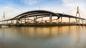 Panorama Twin Suspension bridge connect to highway interchange in Bangkok Thailand during sunset Stock Image