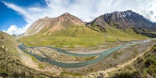 Panorama of twisting river Jil-Suu in Kirgizia Royalty Free Stock Images