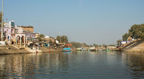 Panorama of two banks of river in indian city Stock Photos