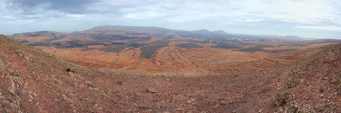 Panorama of typical volcanic interior of Lanzarote. Royalty Free Stock Photo