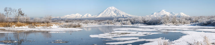 Panorama of ul winter landscape. Grand panorama of beautiful winter landscape with volcano and lake Royalty Free Stock Photography