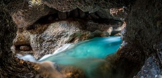 Panorama of the underground lake in a cave of bright blue color Royalty Free Stock Image
