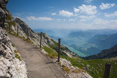 Panorama of the Upper Engadine from Muottas Muragl, Switzerland. Panorama of the Upper Engadine from Muottas Muragl with very steep trail, Switzerland Royalty Free Stock Photos