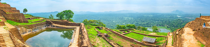 Panorama of the Upper Palace of Sigiriya. With the cistern, full of water, ancient ruins and the green plain on the background, Sigiriya, Sri Lanka Stock Photos