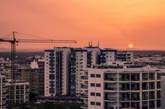Panorama urbain, lever de soleil Image libre de droits