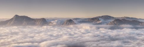 Panorama of Urkiola and Gorbea mountains. At foggy morning stock photography