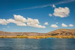 The Uros island from a boat on the Titicaca Lake, Peru. Panorama of the Uros island from a boat on the Titicaca Lake, Peru Stock Photo