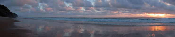 Panorama at Vale Figueiras beach in Portugal. Europe at sunset Stock Images