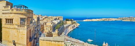 Panorama of Valletta from Upper Barrakka Gardens viewpoint, Malt. Observe the city panorama from the viewpoint of Upper Barrakka Gardens with Grand Harbour Royalty Free Stock Images