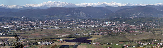 Panorama of valley. Panorama in western Slovenia. Multiple villages and cities in the picture. In the background are visible Julian Alps Royalty Free Stock Image