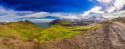 Panorama of valley with the Arctic sea and the mountains in Iceland Stock Photo