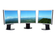 Panorama of valley on computer screens stock images