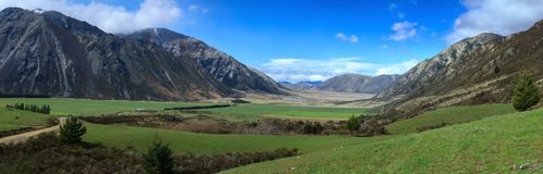 Panorama of a valley in New Zealand`s Southern Alps stock photography