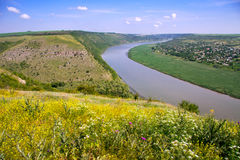 Panorama of the valley with a steep bank and the river. With yel Royalty Free Stock Images