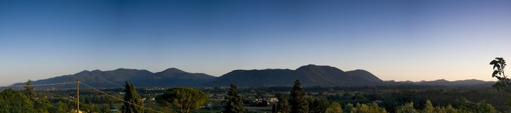 A panorama of valley in Tuscany at sunset with mountains in the background, Tuscany, Italy stock images