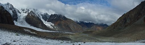 Panorama of valley with view to snow mountains. Beautifull valley with view to snow mountains in Altaj, Russia at the summer stock photography