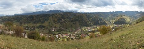 Panorama of the valley with the villages at the foot of the Carpathian Mountains not far from the  city of Bran in Romania Royalty Free Stock Photography
