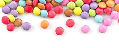 Panorama van kleurrijk die suikergoed op wit wordt geïsoleerd stock foto's
