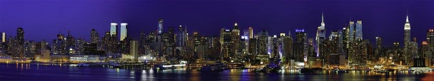 New York Manhattan Panaroma bij Nacht stock afbeeldingen