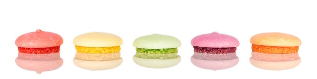 Panorama, variety of colorful biscuits or macarons, isolated on royalty free stock photography