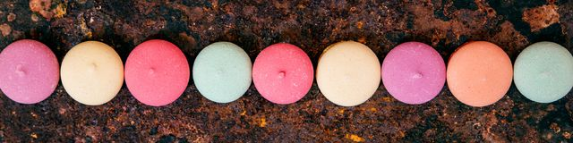 Panorama, variety of colorful cookies or biscuits in a line on r royalty free stock photography