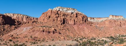 Panorama of a landscape of colorful red rock mesas and cliffs in the American Southwest royalty free stock photography