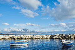 Panorama of Vesuvius. And moored fishing boats at Naples Royalty Free Stock Image
