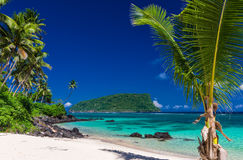 Panorama of vibrant tropical Lalomanu beach on Samoa Island with Royalty Free Stock Photography