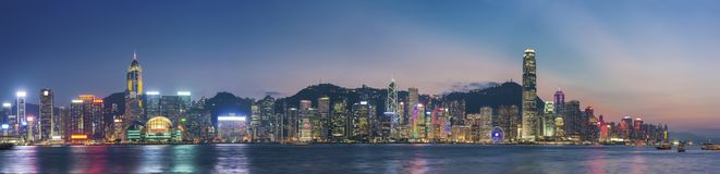 Victoria Harbor in Hong Kong at dusk. Panorama of Victoria Harbor in Hong Kong at dusk Royalty Free Stock Photography