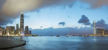 Victoria Harbor of Hong Kong at dusk. Panorama of Victoria Harbor of Hong Kong at dusk Stock Photos