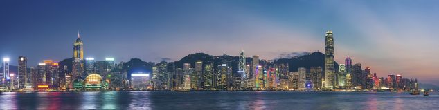 Victoria Harbor of Hong Kong at dusk. Panorama of Victoria Harbor in Hong Kong at dusk Royalty Free Stock Image