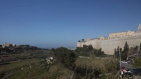 Panorama video of Mdina city historic walls and surrounding nature. Mdina is the former historic capital of the Malta island stock video footage