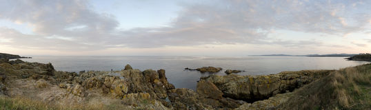Panorama view. Of a rocky coast Stock Photos