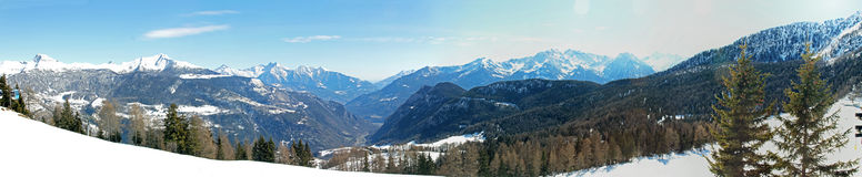 Panorama view of alpine mountains in italy. Panorama view of snowy alpine mountains in italy Stock Images