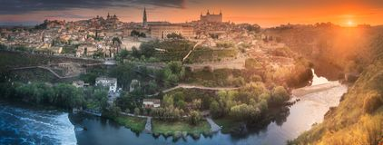 Panorama view of Toledo and Tagus River, Spain. Panorama view of ancient city and Alcazar castle on a hill over the Tagus River, Castilla la Mancha, Toledo Royalty Free Stock Image