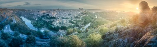 Panorama view of Toledo and Tagus River, Spain. Panorama view of ancient city and Alcazar castle on a hill over the Tagus River, Castilla la Mancha, Toledo stock photography