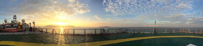Panorama view on backdesk from helideck in seismic vessel ship during sunset in Andaman Sea royalty free stock photography