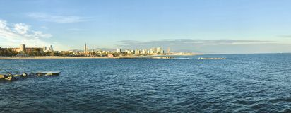 Panorama view of Barcelona from Mediterranean sea. Barceloneta beach and cityscape stock image
