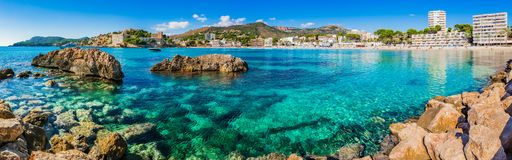 Spain Majorca, beach seaside of Paguera, Spain Mediterranean Sea. Panorama view of beautiful coastline in Peguera, beach of Platja Palmira, Majorca Spain royalty free stock images