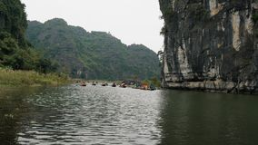 Panorama view of beautiful karst scenery, river and rice paddy fields. TAM COC, VIETNAM - DECEMBER 17, 2018: Panorama view of beautiful karst scenery, river and stock video
