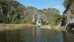 Panorama view of beautiful karst scenery, wetlands. Scenic view of beautiful karst scenery, wetlands seen from the boat at Van Long Nature Reserve, Vietnam stock video