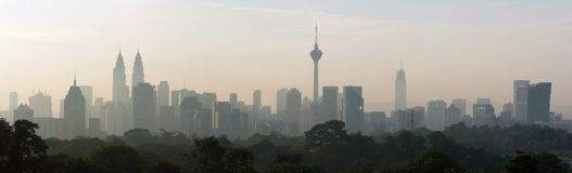 Panorama view of beautiful kuala lumpur cityscape skyline in the hazy or foggy morning enviroment. And buildings in silhouette royalty free stock photo