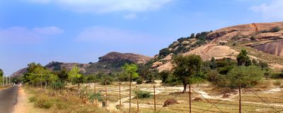 A panorama view of beautiful rock hill of sittanavasal cave temple complex. Sittanavasal is a small hamlet in Pudukkottai district of Tamil Nadu, India. It is stock images